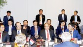 Vietnamese Prime Minister Nguyen Xuan Phuc joins a business roundtable in La Haye capital