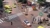 Cảnh sát đặc nhiệm phong tỏa hiện trường cuộc tấn công ở Liege, Bỉ, ngày 29-5-2018. Ảnh: AP