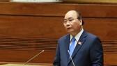 政府總理阮春福就政府若干責任問題進一步明確及回答國會代表的質詢。(圖源:日北)