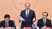 阮春福總理(中)在會議上發表講話。(圖源:光孝)