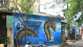 河內朗炮台街中央婦女學院集體的 社群建造藝術項目一幅壁畫。