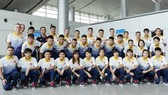 Vietnam women & men futsal teams pose photo at Tan Son Nhat Airport before arriving in Malaysia
