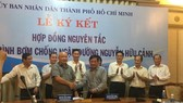 A view of the principle contract signing ceremony on October 2 (Photo: SGGP)