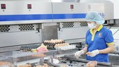 A chicken egg processing plant of Ha Huan Company, loaned by Vietcombank