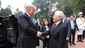 Party General Secretary and President Nguyen Phu Trong (R) welcomes US President Donald Trump before their talks in Hanoi on February 27 (Photo: VNA)