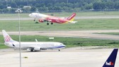 Mở rộng sân bay Tân Sơn Nhất cần tìm lời giải trong bài toán phát triển chung. Ảnh: CAO THĂNG