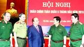 Thủ tướng Nguyễn Xuân Phúc và  các đại biểu tham dự  Hội nghị  Quân chính toàn quân  6 tháng  đầu năm 2018  Ảnh: TTXVN