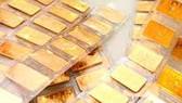 Vàng và chứng khoán đồng loạt giảm giá