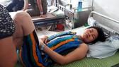 Bệnh nhân Hồ Thị Thảo đang được điều trị tại BV Bạch Mai trong tình trạng bị liệt nửa người