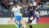 Messi (phải) và đồng đội không khó để giành chiến thắng trước Malaga. Ảnh: Getty Images