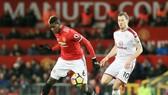 Paul Pogba (trái) và Man.United đã có ngày Boxing Day thất vọng. Ảnh: Getty Images
