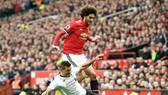 Marouane Fellaini trong lần đối đầu Liverpool hồi tháng 3. Ảnh: Getty Images