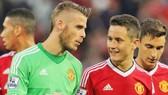 Ander Herrera (phải) tin David de Gea sẽ cùng anh ở lại Man.United. Ảnh: Getty Images