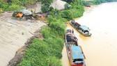 Nước lũ lớn trên sông Hồng đoạn qua địa phận tỉnh Lào Cai (ảnh chụp ngày 4-8)