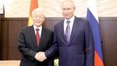 Tổng thống Liên bang Nga Vladimir Putin cùng Tổng Bí thư Nguyễn Phú Trọng                                                . Ảnh: TTXVN