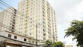 Tổ chức tháo dỡ phần xây dựng sai phép của chung cư Khang Gia