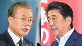 Japanese Prime Minister Shinzo Abe, left, and South Korean President Moon Jae-in (Source Photo by AP)