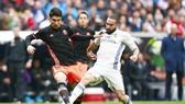 Valencia (trái) sẽ là thử thách lớn của Real Madrid