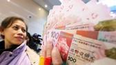 Trung Quốc ấn định mức tiền mặt được rút ở nước ngoài