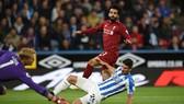 Tiền đạo Salah (áo đỏ) ghi bàn thắng duy nhất mang lại chiến thắng cho Liverpool trước Huddersfield.