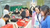 Khách tham quan hội nghị Kết nối cung cầu hàng hóa giữa TPHCM và các tỉnh, thành phố năm 2018. Ảnh: CAO THĂNG