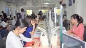 Tiếp nhận hồ sơ của cá nhân và doanh nghiệp tại Phòng Đăng ký kinh doanh Sở KH-ĐT. Ảnh minh họa
