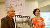 "AP photographer Nick Ut presents his photo, ""The Napalm girl"" to the Vietnamese Women's Museum."