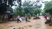 28 dead & missing in flash floods after storm Son Tinh
