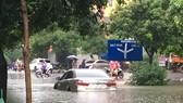 Heavy rains may flood many streets in downtown Hanoi  