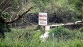 Một ống xả thải của doanh nghiệp xả trực tiếp xuống sông