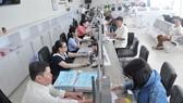 Triển khai thu thuế điện tử toàn bộ ở TPHCM và Hà Nội