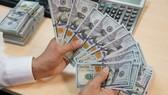 Tỷ giá trung tâm tăng mạnh 13 đồng, vàng trong nước giảm nhẹ