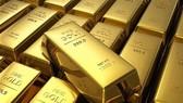 Những thanh vàng trưng bày tại Triển lãm Vàng ở Frankfurt am Main, Đức ngày 10/4/2018. (Ảnh: AFP/TTXVN)