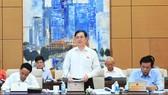 Chủ nhiệm Ủy ban Khoa học, Công nghệ và Môi trường Phan Xuân Dũng báo cáo thẩm tra sơ bộ dự án Luật