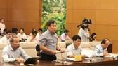 Thứ trưởng Bộ Kế hoạch và Đầu tư  Vũ Đại Thắng trình bày Tờ trình dự án Luật Doanh nghiệp (sửa đổi)