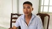 Đối tượng Nguyễn Quang Minh tại cơ quan công an. Ảnh: CHÍ THẠCH
