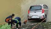 Tìm thấy thi thể tài xế taxi lao xuống sông