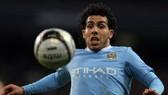 Two-goal Tevez back to haunt United