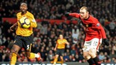 Four-star Rooney sends United top