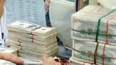 Ngân hàng Nhà nước tăng tỷ giá liên ngân hàng