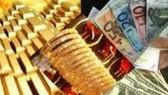 Giá vàng tăng nhẹ, tỷ giá USD trái chiều