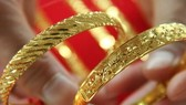 Giá vàng hạ nhiệt trên thị trường châu Á