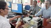 Cuối 2013, nợ xấu toàn hệ thống ngân hàng 3,79%