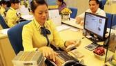 """Fitch nâng triển vọng tín nhiệm Việt Nam lên """"tích cực"""""""