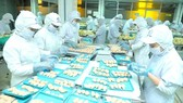 Workers process food at a Korean company in Ho Chi Minh City. (Photo: SGGP)