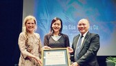 Actress and director Pham Hong Anh (centre) receives the Certificate of Appreciation for her feature film from Mrs Astrid Bant (left) and Mr Vu Dang Minh (Photo courtesy of Hong Anh)