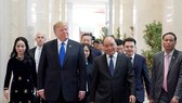US President Donald Trump is welcomed by PM Nguyen Xuan Phuc at the Government Office where the two leaders had lunch together. (Photo: Sggp)