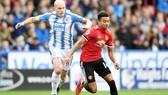 Man.United (đỏ) đã nhận thất bại đầu tiên ở mùa giải mới.Ảnh: Getty Images.