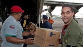 Haitians await rescuers as quake toll may top 100,000