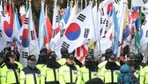 Park's supporters rally outside court as impeachment ruling nears